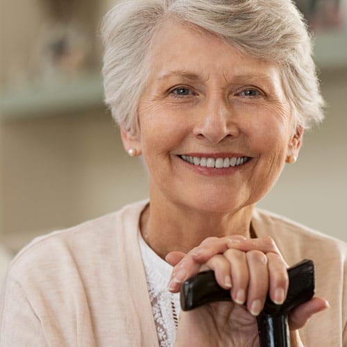 happy senior woman with a cane